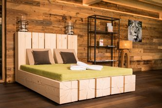 Tree trunk bed from regional light wood